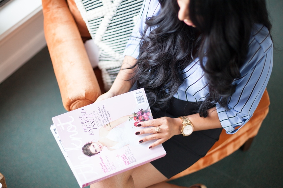 girl looking at magazine